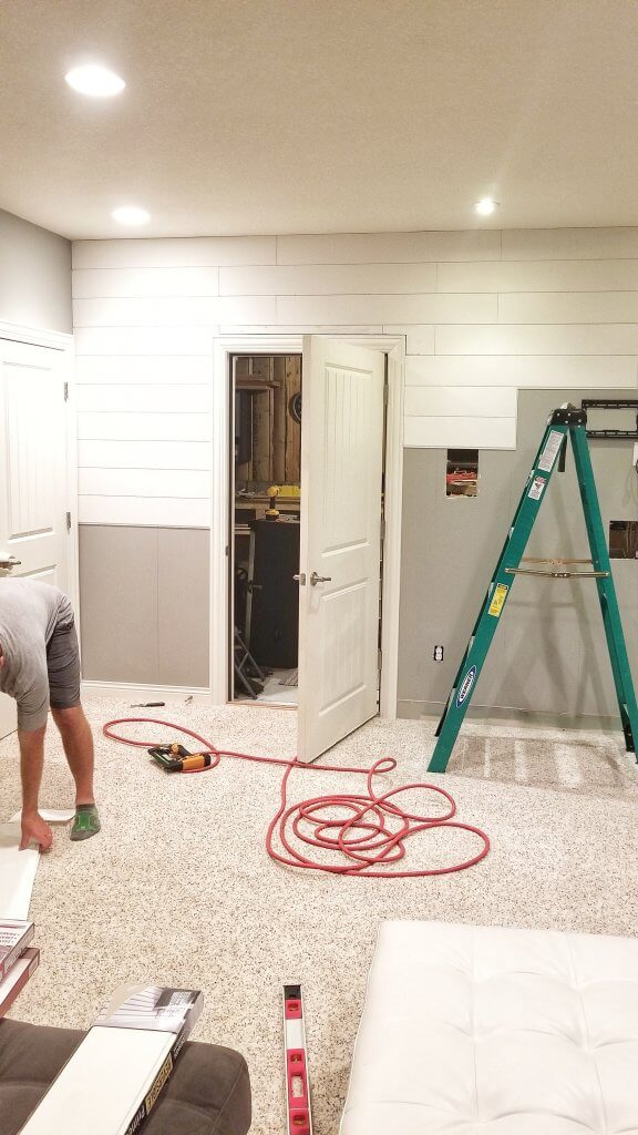 See how we created a diy gorgeous focal wall in our basement with shiplap